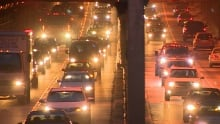 Gridlocked traffic at nighttime in one of Vancouver's busiest tunnels.