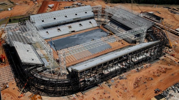 In this Sept. 2013 file photo released by Portal da Copa shows an aerial view of the Arena Pantanal stadium in Cuiaba. Brazil risks missing the December deadline for the delivery of its World Cup stadiums because of a legal battle over the purchase of seats for this venue.