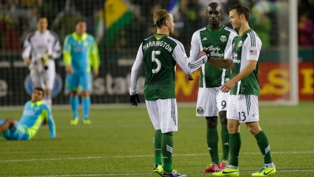 Portland Timbers' Michael Harrington (5) Mamadou Danso, second from right, and Jack Jewsbury, right, celebrate the Timbers 3-2 win over the Seattle Sounders on Thursday.