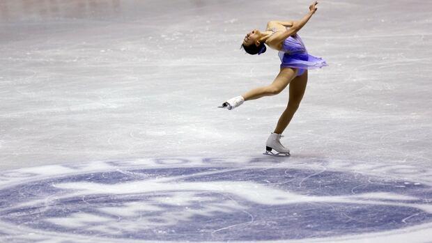 Mao Asada skates her short program in the NHK Trophy at Yoyogi National Stadium in Tokyo on Friday.