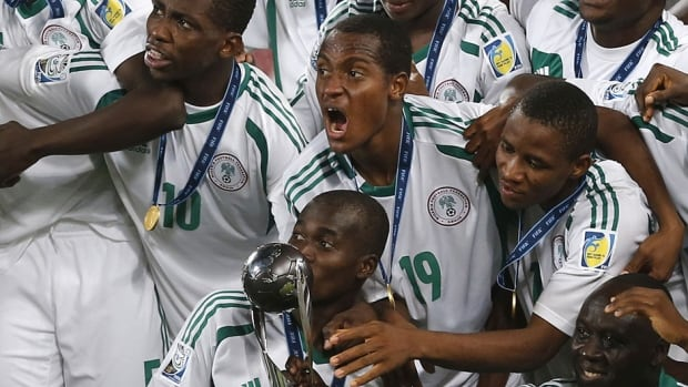Nigerian players celebrate their 3-0 win over Mexico in the FIFA U-17 World Cup final on Friday in Abu Dhabi. The victory was a record-setting fourth for the Nigerians.