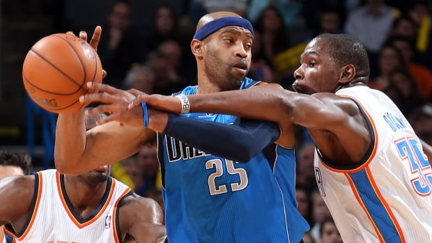 The Mavericks' Vince Carter, left, was suspended one game Friday for throwing an elbow and making contact with the head of Oklahoma City centre Steven Adams during Wednesday's game.