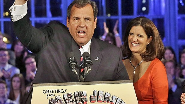 New Jersey Gov. Chris Christie and his wife, Mary Pat, wave to supporters after the Republican governor's overwhelming re-election win Tuesday in a Democratic state.