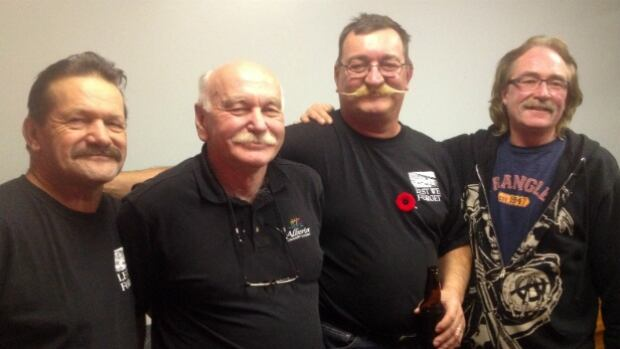 Mike Makcrow, from left, Willy Smith, Greg Forfey and Lyle Kent say the moustache is known in trucking circles as a 'winter front.' This month — they say — the Bowness Legion is putting out a calendar featuring Branch 238 men with lots of of 'bare skin and facial hair.'