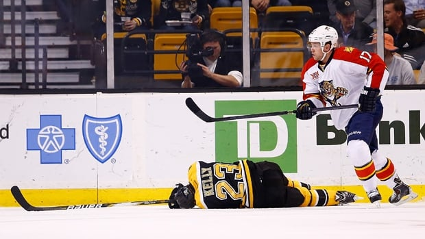 Jesse Winchester (17) of the Florida Panthers skates away after knocking Chris Kelly (23) of the Boston Bruins to the ice in the first period at TD Garden on Thursday.