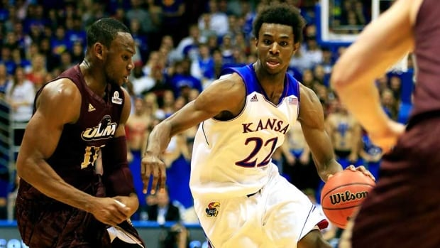 Canadian Andrew Wiggins scored 16 points in his highly anticipated debut for Kansas on Friday.