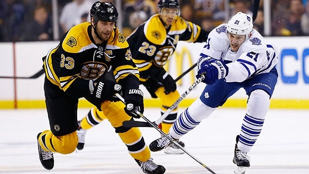 James van Riemsdyk of the Toronto Maple Leafs, right, and Zdeno Chara of the Boston Bruins in Game Seven of the Eastern Conference Quarterfinals on May 13, 2013 at TD Garden in Boston, Massachusetts.
