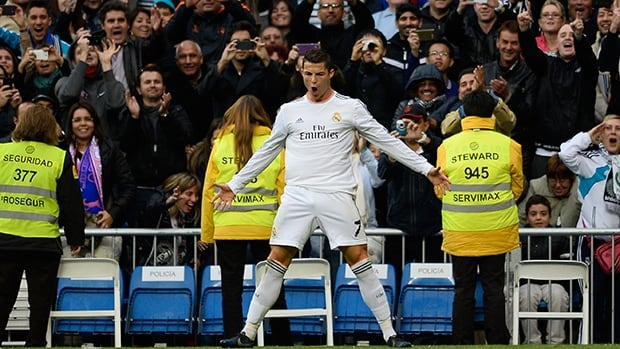 Real Madrid's Cristiano Ronaldo celebrates after scoring against Real Sociedad on November 9, 2013 at the Santiago Bernabeu stadium in Madrid.