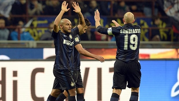 Inter Milan players celebrate a goal against Livorno at San Siro Stadium on November 9, 2013 in Milan, Italy.