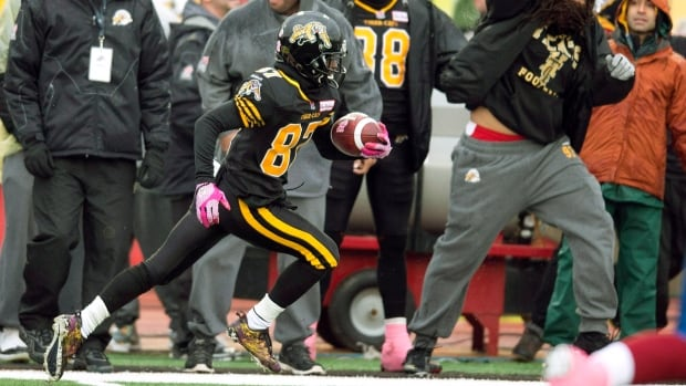 Hamilton Tiger-Cats kick returner Brandon Banks runs up field on his 107 yard touchdown return against the Montreal Alouettes in fourth quarter CFL action in Guelph on Oct. 26, 2013.