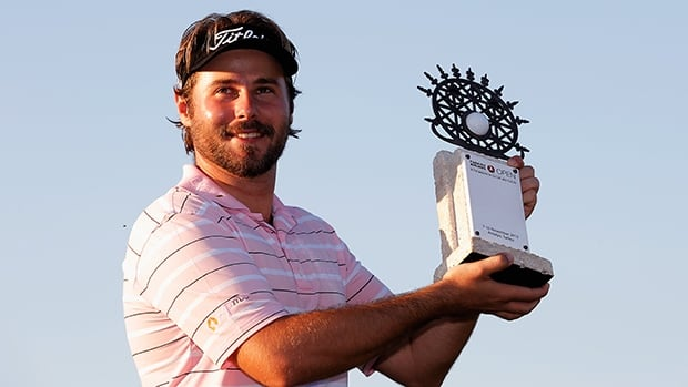 Victor Dubuisson poses with the trophy after winning the Turkish Airlines Open at The Montgomerie Maxx Royal Course on November 10, 2013 in Antalya, Turkey.