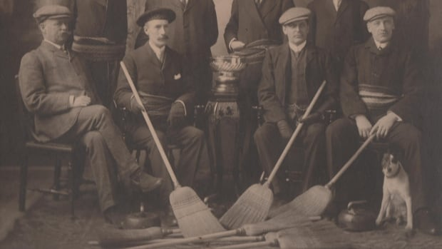 This curling rink of former governors general is captured here in their formal garb in 1908.