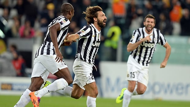 Andrea Pirlo of Juventus, centre, celebrates scoring against Napoli at Juventus Arena on November 10, 2013 in Turin, Italy.