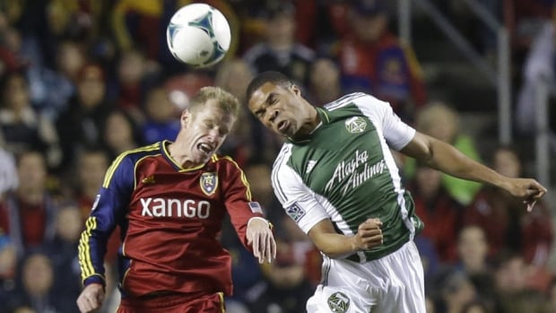 Real Salt Lake's Nat Borchers (6) and Portland Timbers' Ryan Johnson, right, battle for a ball in the first half during the first leg of the MLS Western Conference final on Sunday in Sandy, Utah.