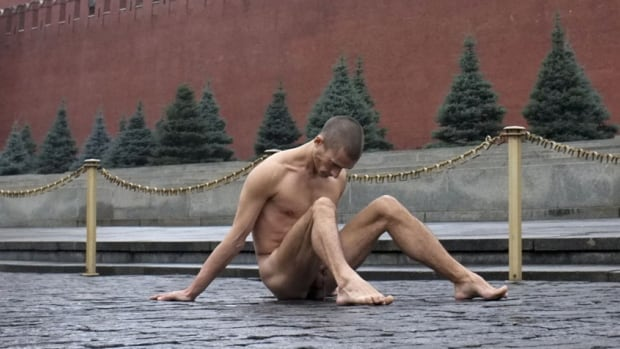 Performance artist Pyotr Pavlensky sits on the pavestones of Moscow's Red Square during a protest action in front of the Kremlin wall on Sunday. Pavlensky nailed himself to the cobblestones by his genitals as part of an art performance in protest against what he sees as the prevailing apathy in contemporary Russian society and the police state-like tactics of the government of President Vladimir Putin. The performance coincided with Police Day, a day when the Russian Interior Ministry honours its service members.