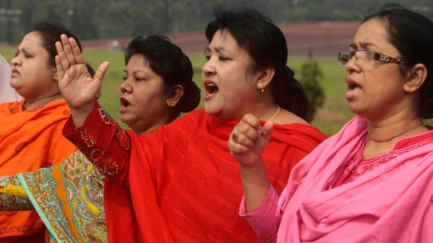 Main opposition Bangladesh Nationalist Party lawmakers shout slogans outside the Parliament during a general strike in Dhaka, Bangladesh.