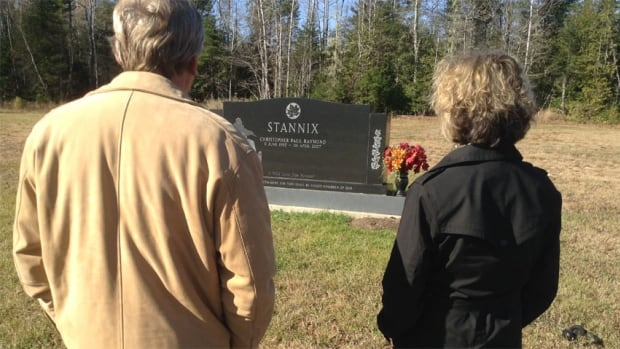 Kate and Ken Stannix stand at the grave of their son Master Cpl. Chris Stannix who was killed in Afghanistan.