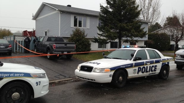 Gatineau police cordoned off a home on Pierre Lafontaine Street after a body was found there Monday, Nov. 11, 2013.