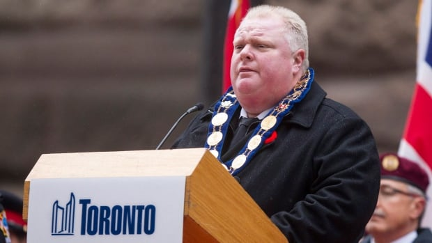 Toronto Mayor Rob Ford speaks from the podium at the cenotaph during a Remembrance Day service in Toronto on Monday.