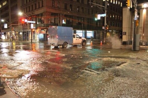 Water main breaks at Bay and Richmond