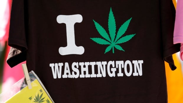 A shirt celebrating the legalization of marijuana in Washington state is displayed at a festival in Seattle in August. Now the city of Washington, D.C., the nation's capital, is poised to pass a measure that would decriminalize possession of small amounts of the drug.