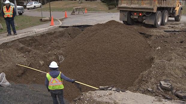 Saint John crews work to repair a watermain break and sinkhole in the city's north end
