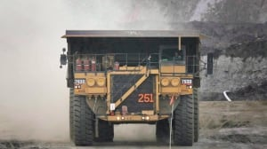 A pickup truck leads a haul vehicle at an oilsands mine near Fort McMurray, Alta., in July 2008. Ottawa says Europe's fuel quality directive unfairly discriminates against Alberta bitumen.