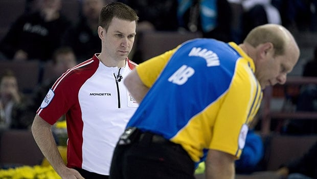 Brad Gushue, left, has found himself playing alongside longtime rival, Alberta's Kevin Martin. The two are seen competing last March.