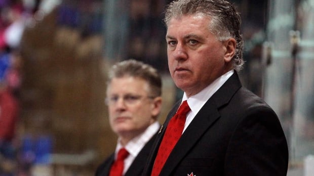 Doug Shedden, right, served as an assistant coach at the Spengler Cup in 2009 and 2010.
