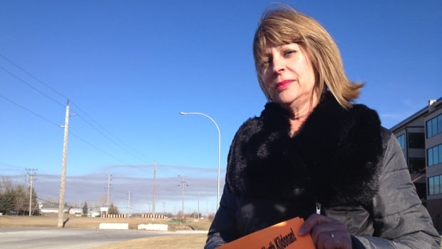 Cathy Cox has handed out 2,500 pamphlets protesting the development of the big box mall.