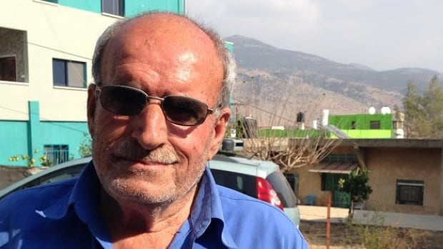 Jamal Silwan lives in Ghajar, a village whose residents largely say they are Israeli while their loyalties lie with Syria. The war in Syria is never far from their minds: 'We hope this will end and there will be peace so everyone can live together – Jews, Muslims and Christians,' Silwan says.