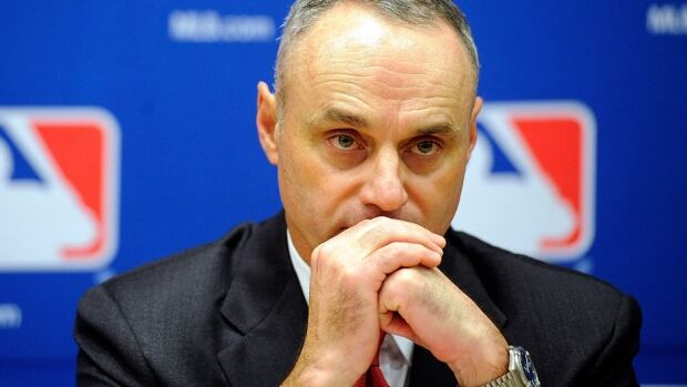 MLB's chief operating officer Rob Manfred said present and former umpires likely would make the decisions on contested calls after reviewing video in New York.