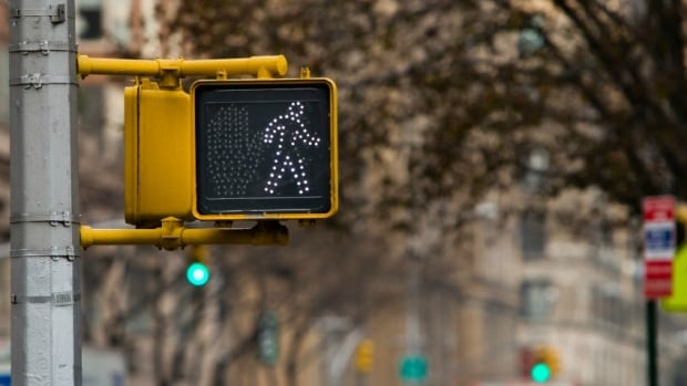 "Besides the confusion, there's is a difference in the time given to cross if a ""Walk"" signal is not requested."