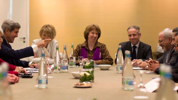 U.S. Secretary of State John Kerry jokes with European Union foreign policy chief Catherine Ashton (centre) and Iranian Foreign Minister Mohammad Javad Zarif at the Iran nuclear talks in Geneva earlier this month, the kind of interaction that would have been unheard of under the former regime.