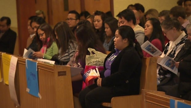 About 200 people attended a prayer vigil at St. Theresa's church on Thursday, including many people from the local Filipino community.
