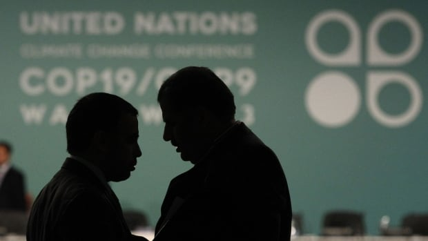 Delegates talk during a break in a plenary session at the 19th conference of the United Nations Framework Convention on Climate Change (COP19) in Warsaw. World leaders are backing away from the 2015 target for a global climate treaty to succeed the Kyoto Protocol.