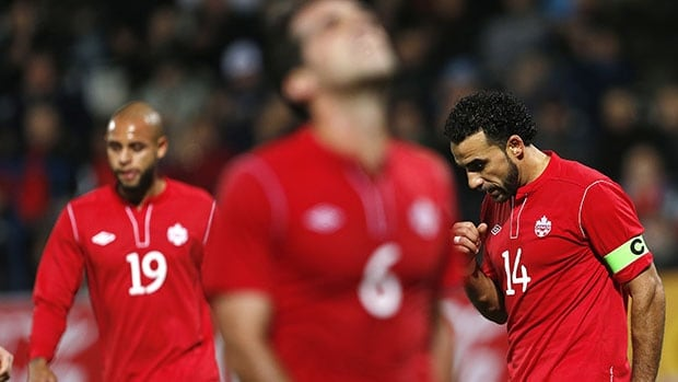 Canada's Dwayne de Rosario, right, reacts with teammates Pedro Pacheco de Melo, centre, and Kyle Porter after missing a penalty shot against the Czech Republic in Friday's friendly.