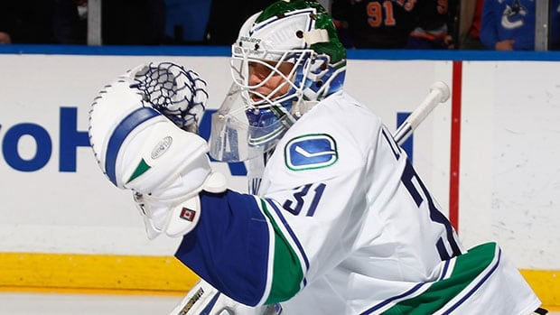 Eddie Lack has a 2-2-0 record and .911 save percentage this season behind Canucks' No. 1 goalie Roberto Luongo.