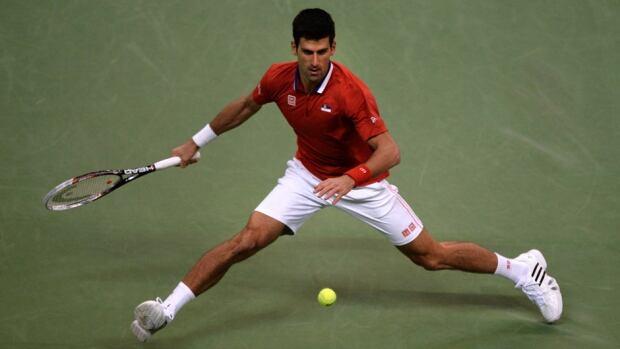 Novak Djokovic returns the ball to Radek Stepanek during the Davis Cup final between Serbia and the Czech Republic at the Kombank Arena in Belgrade on November 15, 2013.