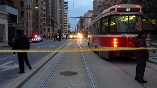 Police cordone off the scene of a fatal accident involving a TTC streetcar and an 81-year-old woman, at Yonge and St. Clair.