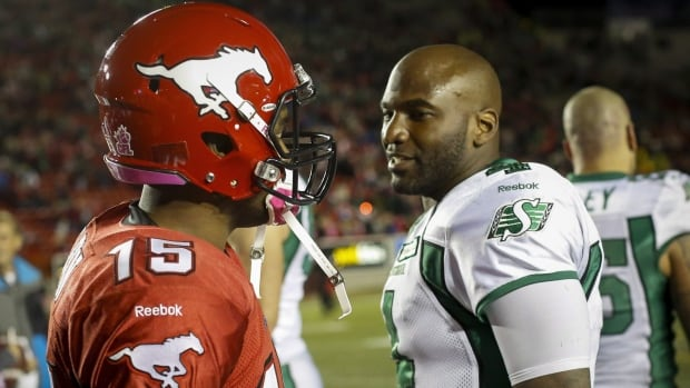 Saskatchewan Roughriders quarterback Darian Durant, right, talks to Calgary Stampeders quarterback Kevin Glenn, following the game Oct. 26.