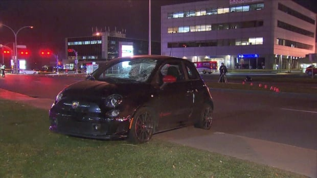 A young woman standing on a median suffers serious injuries, after being hit by a car involved in a collision.