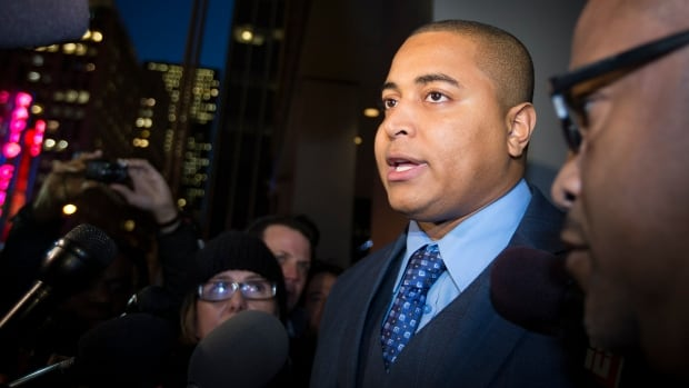 Miami Dolphins lineman Jonathan Martin speaks to members of the media outside the office of the NFL lawyer investigating the team's bullying scandal Friday in New York. The league is trying to gather information about the harassment Martin says he was subjected to by teammate Richie Incognito.