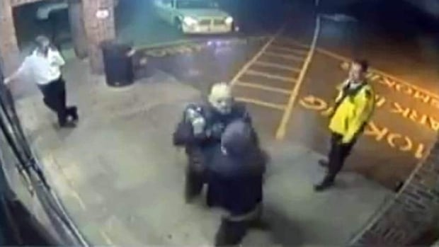 A freeze frame from a surveillance video shows the interaction between Barrie Const. Jason Nevill and Jason Stern. Nevill, who was sentenced to one year in prison for the assault, has now tendered his resignation with the force.