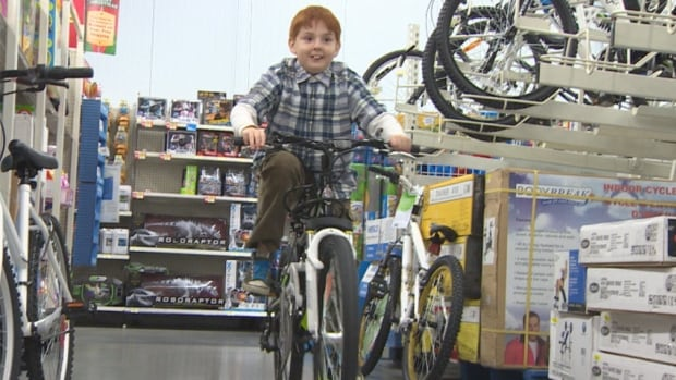 12-year-old Nathan Antone rides his new bicycle.