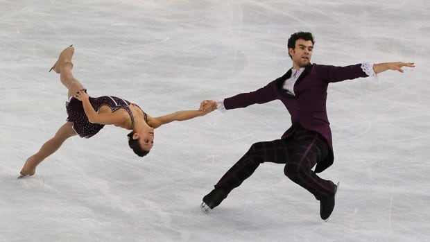 Meagan Duhamel, left, and Eric Radford, right, perform in the pairs free skating event at the ISU Figure Skating Eric Bompard Trophy in Paris in November, 2013. The duo take to the ice at 12:10 p.m. ET in the qualification round for the team pairs short program event at the Sochi Olympics today.
