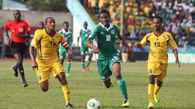 Nigeria's Mikel John Obi, centre, challenges for the ball with Ethiopia's Adane Girma left, and Shemeles Bekele, right, during their 2014 World Cup qualifying playoff second leg match at U. J. Esuene Stadium in Calabar, Nigeria on Saturday.