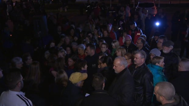 Around 200 people crowded into the parking lot at Conception Bay South town hall for a vigil remembering Juliane Hibbs and Vince Dillon on Friday night.