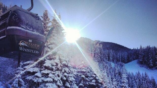 Sun and snow at Creekside Gondola at Whistler.