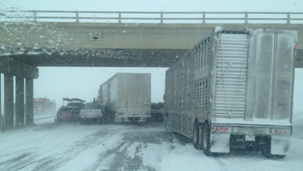 Upwards of 40 people are stranded after a multi-vehicle crash near Crossfield that involved several semi tractors.